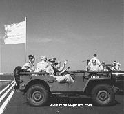 OD painted USN marked Jeep - perhaps the first documented example of the famous 'Jeep Wave'.