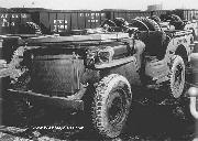 Truck, 1/4-ton, 4x4 Willys MB with windshield and radiator barricaded with plywood, Newport News, VA, 23 March 1943. The plywood is fastened with steel tape to hold the windshield down for overseas shipment. From Preparation of Unboxed Ordnance Materiel for Shipment. an Ordnance Department publication.