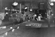 MB Jeeps are under manufacture on an assembly line in a Willys-Overland Motors plant in Toldeo, Ohio. 1943.