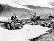 Willys Slatgrill MB Army Jeeps and two Marmon-Herrington CTLS US Tanks maneuvering in a mountain pass in Alaska. Summer, 1942.