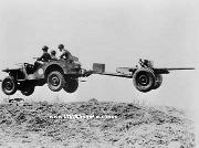 A Bantam BRC prototype jeep and towed M3 antitank gun going airborne during testing at New River, North Carolina.
