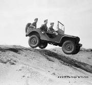Ford GP prototype 1/4 ton 4X4 Light Reconnaissance Car. Military Personnel Driving Jeep down Dunes at Pine Camp, 8/8/1941