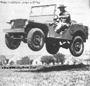 1941 Ford GP Prototype Army Jeep getting airborne. Mid-Air in Jump.