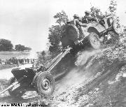 1941 Ford GP Jeep prototype 1/4 ton 4X4 Light Reconnaissance Car on testing maneuvers towing a 37mm anti-tank gun over rough terrain in Wadesboro, NC in Nov. 1941.