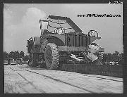 1941 Willys MA prototype Jeep at Fort Knox. Maintenance of mechanized equipment. Even the tough little jeeps must be serviced. This vehicle, like all others of its class, makes regular trips to the grease pit for lubrication, adjustment, and general inspection. June 1942.