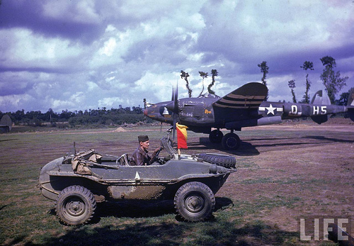 A German Schwimmwagen captured by the Americans. Repainted with the White Star and put into service in France with the 392nd Fighter Squadron, 367th Fighter Group, 9th Army Air Force who are getting ready to fly a mission on August 26, 1944.